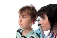Paediatrician checking ears