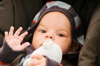 Baby in Car Seat waving