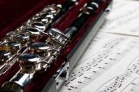 Transverse Flute in case on Sheet of Music