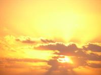 Yellow sunrise emits rays and beams