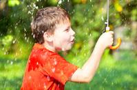 boy under an umbrella during a rain