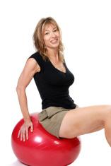 Older women sitting on excerise ball