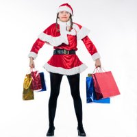 woman dressed as santa claus doing Christmas Shopping carrying b