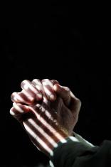 Hands clasped in prayer - closed