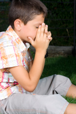 Young boy praying