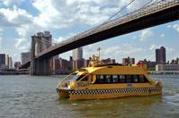 Water Taxi under the Brooklyn Bridge