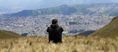 Man looking the City view of Quito, Ecuador
