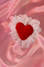 Red Crocheted Heart with Long White Lace on Pink Satin