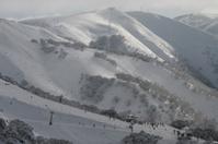 Ski resort with sunshine through the mist