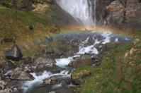 Alpine river with rainbow
