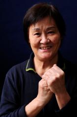 Asian senior woman smiles