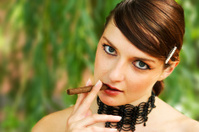 Elegant Young Woman Smoking Cigar