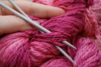 Knitting with pink yarn