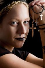 Beautiful and serene woman holding crucifixes
