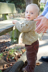 Baby boy in park first step