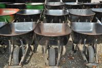Lined Up Wheelbarrows