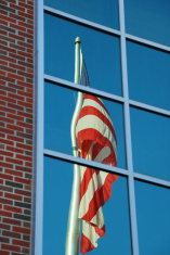 American flag reflecting in window