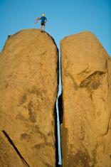 Rock climbing a split pillar.