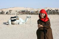 Bedouin girl with Camels in Sahara desert