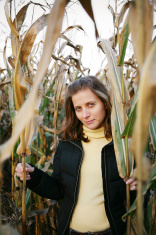smiling girl in plant. autumn