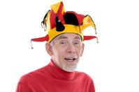 Senior man in funny jester hat