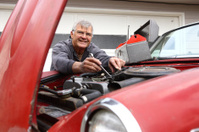 Senior man working on classic car