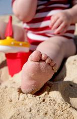 Baby's foot on beach