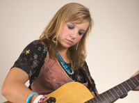 Pretty Blond Girl Plays Guitar