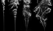 white smooth flowing smoke on black