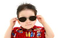 Adorable Boy In Dark Sunglasses And Hawaiian Shirt