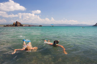 Couple snorkeling on beach in Mexico