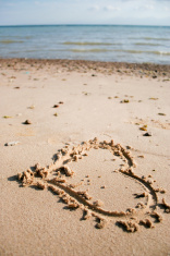 heart scratched into the sand