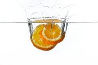 orange splashing into water