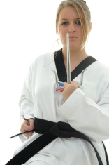 Female black belt with sais