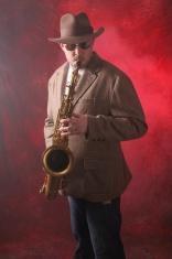 Man Playing Jazz on the Saxophone