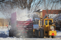 Snow Removing Truck and Blower in the Street