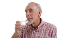 Senior Man Drinking Glass of Water