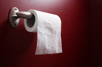 Toilet Paper in Red Bathroom