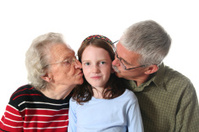 Happy Grandchild Getting Kisses
