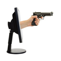 Computer monitor and hand with gun