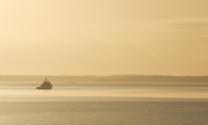 Coast guard boat at sunrise