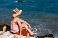 Beautiful fashion girl posing on beach