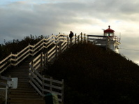 lighthouse on Nova Scotia coast at sunset