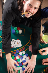 Poker Player Grabbing Winnings