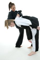 Two women practicing self defense tatics