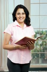 Indian Woman enjoying reading a book