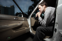Man sitting in his car