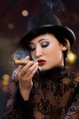 Young Woman Smoking Cigar