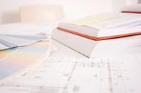 Blueprints,books and agendas close-up