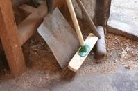 Shovel and Broom In Workshop